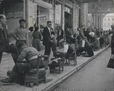 Press Photo Shoeshine row in Athens a long line of shoeshines | eBay