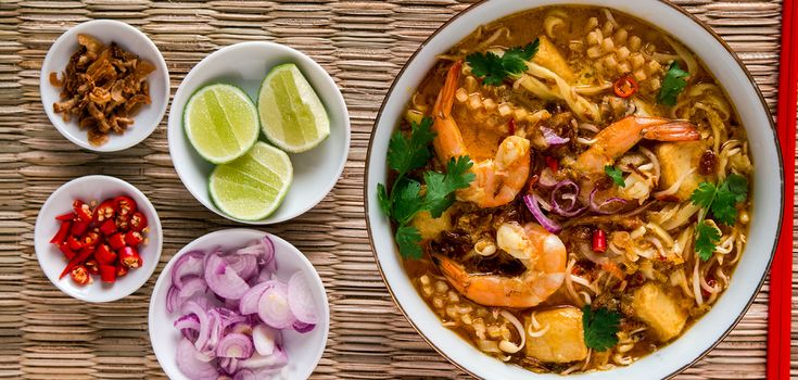 This Singapore laksa recipe is the rich coconut milk-laced version of this Southeast Asian classic noodle soup dish. A great laksa is not made starting from a jar of paste, agreat laksa starts with curry paste made from scratch in a mortar and pestle –...