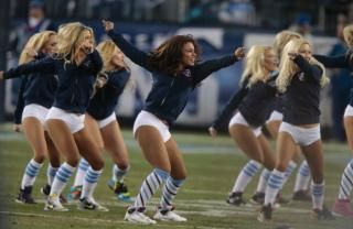 Tennessee Titans cheerleaders perform in the second quarter of an NFL football game between the Titans and the Indianapolis Colts  Thursday, Nov. 14, 2013, in Nashville, Tenn.