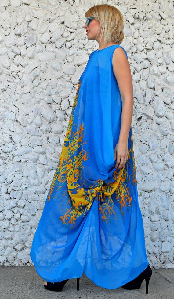 Extravagant royal blue kaftan with colorful print and asymmetrical cut. This sheer loose dress comes with an underneath viscose dress.  Material: underneath dress - 95% viscose, 5% elastane chiffon kaftan - 100% polyester  Care instructions: Wash at 30 degrees  The model in the picture is size S.  Can be made in ALL SIZES.  If you have any other specific requirements, do not hesitate to contact me!  I DO NOT CHARGE EXTRA MONEY for custom made items.   All you need to do is send me your…
