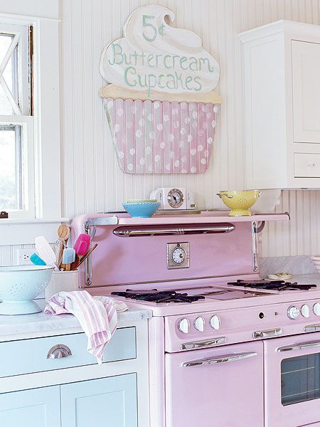 Fantastically sweet pink and aqua vintage kitchen with a darling cupcake sign. Love!