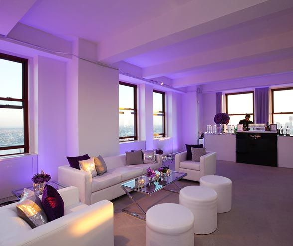 Purple lighting at the cocktail reception for the guests.: Cocktails Hour, Purple Lights, Colour Lights, Blue Lights, Garage, Guest, Empire State Building, White Couch, Cocktails Receptions