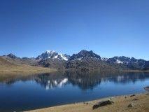 El camino inca continúa por el distrito de Ayapata pura naturaleza más de 12 lagunas en todo el trayecto  al distrito de  Ollachea, donde prima la laguna de Pitumarca donde  aún hay vestigios de unas chullpas.