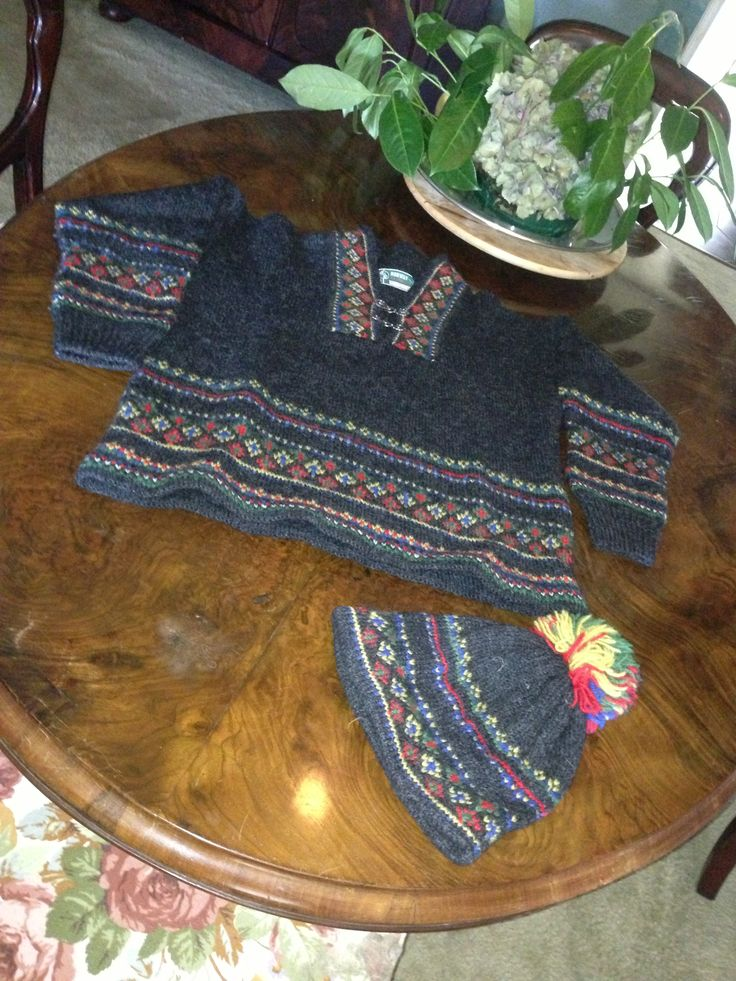 From Norway a typical knitted multicoloured rainproof jumper from original Icelandic lopi