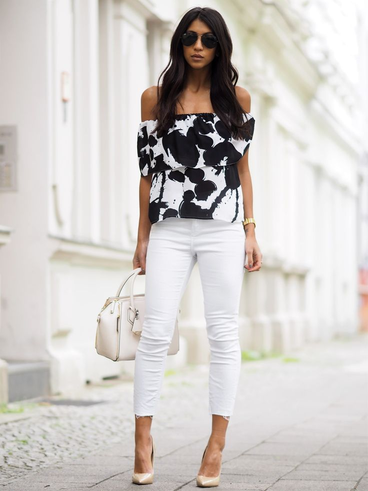 White jeans can also make a perfect match to a more formal top, like this striking monochrome off the shoulder piece worn by Kayla Seah. An elegant outfit like this is perfect for more formal parties and occasions!Shirt/Bag: Rebecca Minkoff, Jeans: Rag & Bone, Heels: Jimmy Choo.