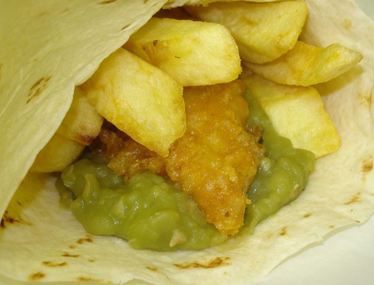 fish and chips with mushy peas in a wrap