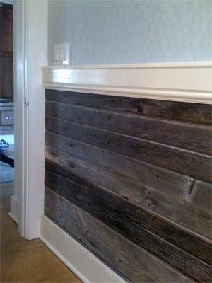 """Little House on the Prairie"" meets modern decor with this wood plank chair rail. Using different-hued pieces of wood will give more depth and dimension to your walls.   Photo:  The Distinctive Cottage"