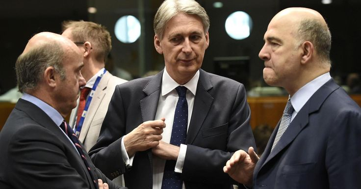 John Thys | AFP | Getty Images Britain's Chancellor of the Exchequer Philip Hammond (C) talks with EU Commissioner of Economic and Financial Affairs, Taxation and Customs Pierre Moscovici (R) as Spain's Economy Minister Luis de Guindos (L) before a session of the Economic... - #Brexit, #Finance, #Goldman, #Hammond, #Long, #Sachs, #Told, #Tr, #UKs