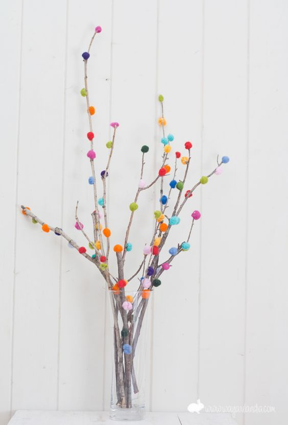 Pom-Pom Branches wedding centerpiece / http://www.himisspuff.com/pom-poms-decor-ideas-for-your-wedding/4/