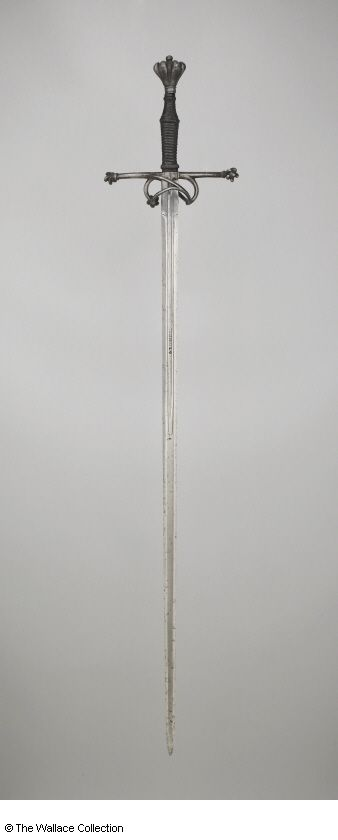 Longsword. Unknown Artist / Maker. Germany. c. 1530 - c. 1540 (pommel and guards (German). Probably late 16th century (blade). Iron or steel, rope and leather, blackened. Length: 103.5 cm. Length: 17.5 cm, grip. Width: 2.8 cm. Weight: 1.3 kg. Inscription: 'SIGNOR' with a cross on both sides. Wallace Collection A492. European Armoury I