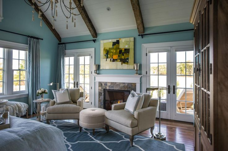 Classic furnishings and architectural details are accented by the gorgeous abstract art above the mantel. #HGTVDreamHome