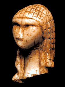 """""""La Dame de Brassempouy"""". Sculpted in ivory, about 25,000 years ago. The oldest known representation of a human face. It was found in France."""