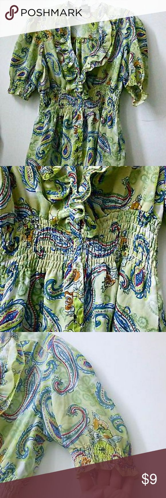 Esmeralda Fashions Size M Top Esmeralda Fashions Size M Green Short Sleeve Top Blouse Elastic Waist Ruffles  Material:100% polyester  Length : 26'' From armpit to armpit : 18.5'' Sleeve length : 12.5'' Esmeralda Fashions Tops