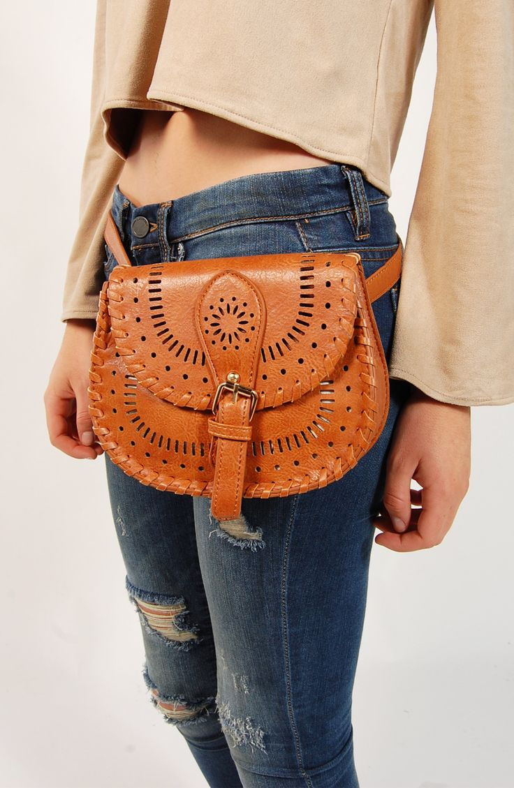 - Vegan leather exterior with laser cut details - Item # GG40708 - The perfect concert accessory! Rock her with your fav distressed jeans, graphic tee and choker for a chill rocker vibe - Spot clean -