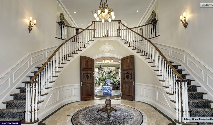 A beautiful butterfly staircase in the grand foyer of this for Mansion foyer designs