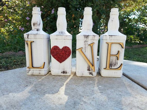 This is our Jack Daniels LOVE set. There are four jack daniels bottles, wooden letters spelling love. Color is chalk white, with brown wash, heart is glitter red. This is a unique home decor piece. Would look great on your mantels, tables, side tables, bedroom or anywhere in your home. This would also make a great gift! Want to give something different? This is it!   If other color is wanted. Please indicate at check out.
