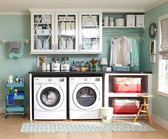 Coax more efficiency and storage from a little laundry room with work areas designed around the wash cycle. This 10×11-foot space smooths out wrinkles with a smart layout, thoughtful organization, and creative labels.