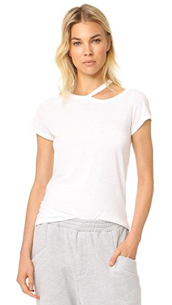 Get this PAM & GELA's top off shoulder now! Click for more details. Worldwide shipping. Pam & Gela Scoop Neck Tee with Cold Shoulder: A shoulder-baring cutout lends an asymmetrical element to this casual Pam & Gela tee. Short sleeves. Fabric: Jersey. 50% polyester/37% cotton/13% rayon. Wash cold. Made in the USA. Measurements Length: 24.5in / 62cm, from shoulder Measurements from size S (top hombros descubiertos, sin hombros, off shoulders, off the shoulder, cold shoulder, off-the-shoulder…