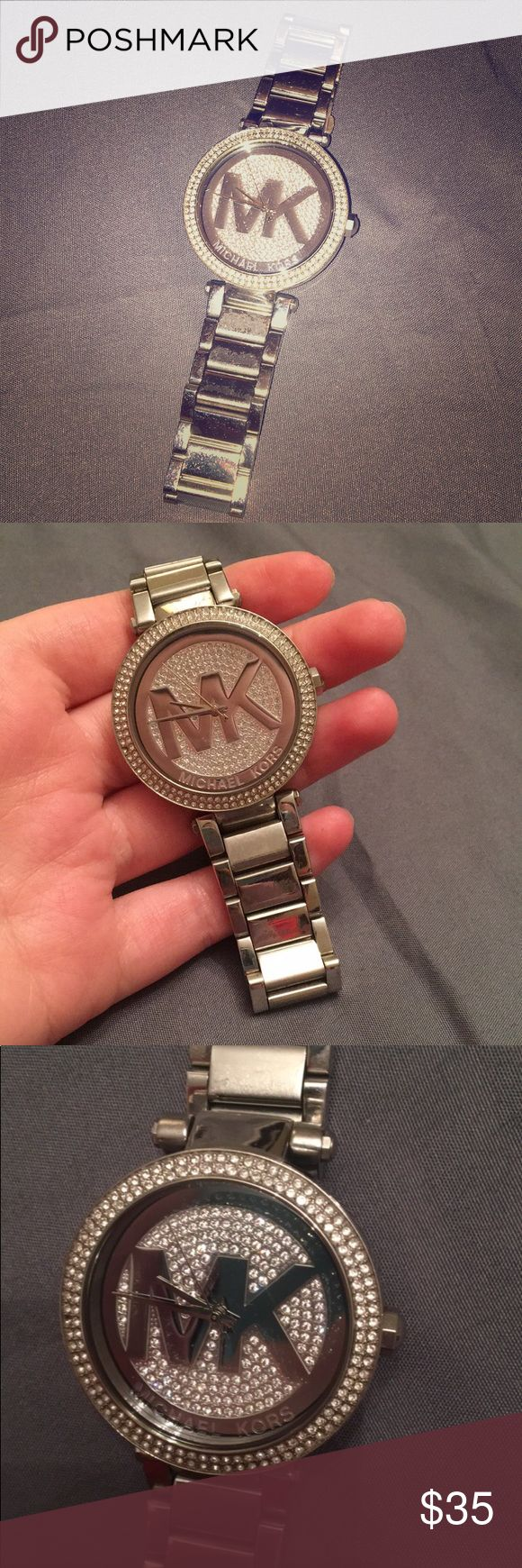 Michael Kors Silver Watch Stainless Steel Michael Kors Watch. Has wear on the inside and of the band but is not noticeable while wearing. Very cute watch and works good, just needs new batteries! Michael Kors Accessories Watches