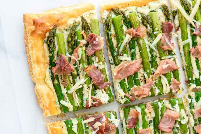 One of our favorite make ahead recipes for Easter brunch: Asparagus Tart using puff pastry. So easy! | Well Plated