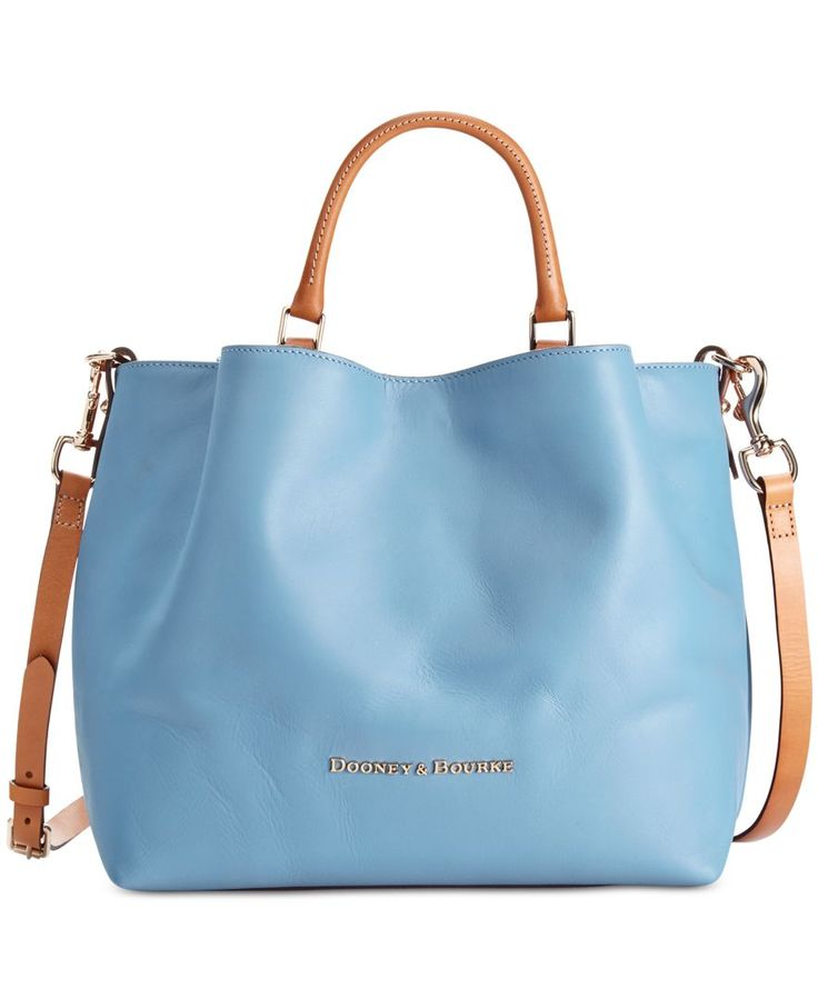 Dooney & Bourke designed this slouchy two-tone tote with rich leather and plenty of space for storing your essentials while you're on the go. This must-have bag features both handles and a detachable