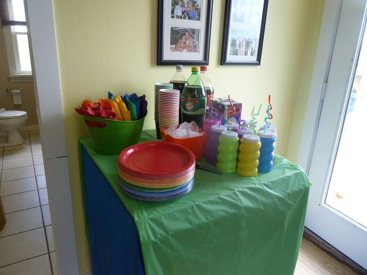 Rainbow colored cutlery roll ups, plates, napkins, cups and water bottles to take home. All from the loonie store.