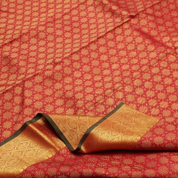 Bridal red #silk is speckled with star-spangled gold buttis to create a magical sheen on this stunning sari. The gold border displays an intricate geometric pattern and is trimmed with a single line in bottle green. Paisleys and peacocks woven in gold on the sunburst golden mustard pallu add a mystical aura. Small inverted paisleys motifs highlight the golden mustard blouse.This Sarangi #Kanjivaram could well be the bride's pride. For saris in this exotic colour, visit Sarangi. Code…