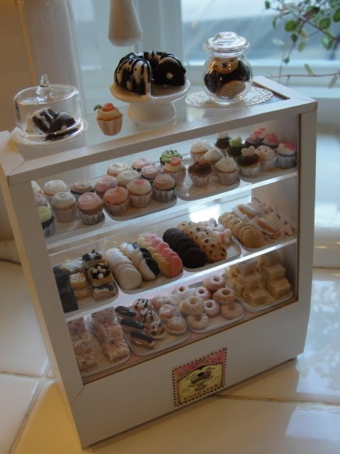 Filled bakery counter  - detailed photos on blog - I wonder what she uses for trays