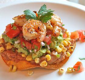 Shrimp & Avocado Tostada- Baked tortilla, refried beans, corn, spiced shrimp, avocado,& Pico de gallo