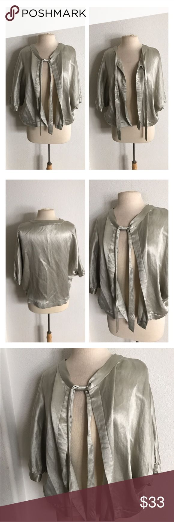 """Elevenses """"Florena"""" shimmer jacket Elevenses """"Florena"""" shimmer jacket. Size S. Measures 24"""". 55% linen/ 45%  cupro. Dolman sleeves. Tie top closure (no other closure). Very silky feeling! Color is more on the silver side with a light hint of gold. Very great used condition.  🚫NO TRADES 💲Reasonable offers accepted 💰Ask about bundle discounts Anthropologie Jackets & Coats"""