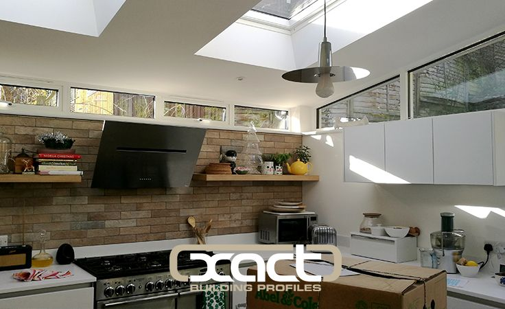 Beautiful kitchen style. XACT Aluminium Windows let in maximum natural light with their narrow frames and simple design. #aluminiumwindows #extensionideas #rooflights #kitchenideas #kitchenremodel