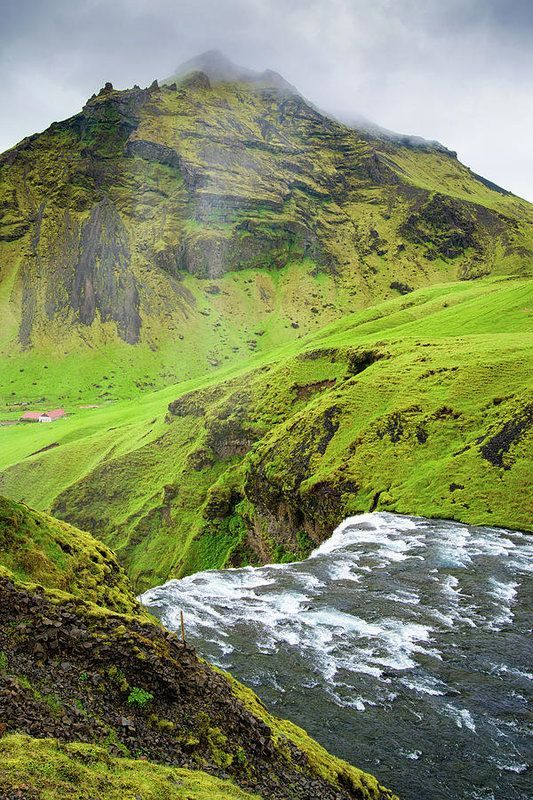 Green Iceland. This is the upper end of the Skogafoss waterfall in Iceland, river Skoga and a lovely green landscape. Available as poster, framed print, metal, acrylic or canvas print. Art for your Home Decor and Interior Design needs by Matthias Hauser.