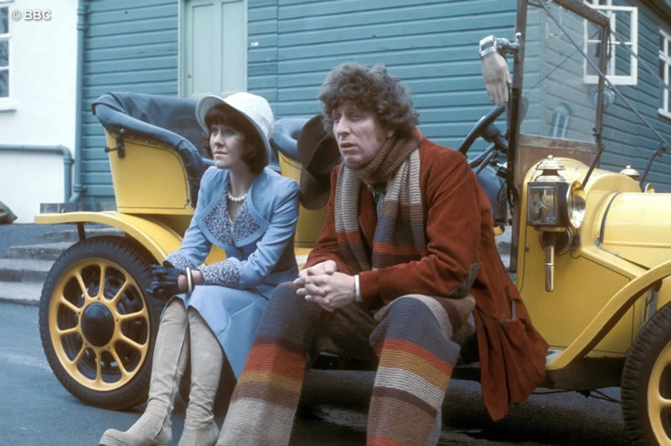 Sarah Jane Smith (Lis Sladen) and the Doctor (Tom Baker) sitting on Bessie's running board. In her little blue suit.