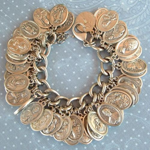 This is awesome. (56 RELIGIOUS CATHOLIC SAINT MEDALS CHARM BRACELET)