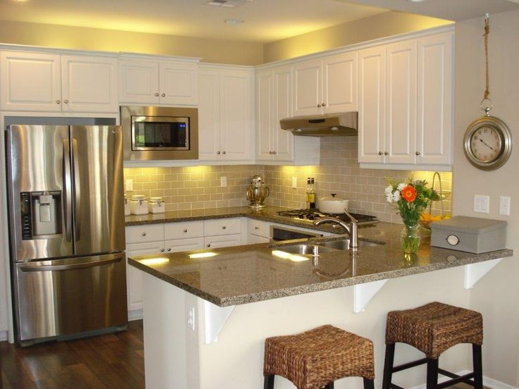 Traditional Kitchen with Breakfast bar, Hardwood floors, Limestone Tile, High ceiling, U-shaped, Raised panel, Flush