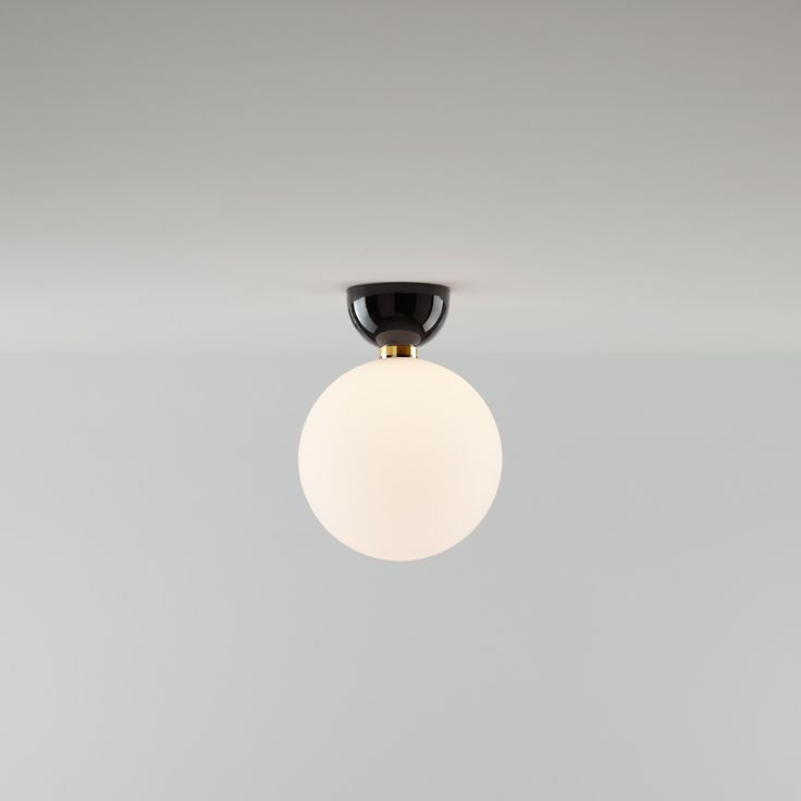 Jaime Hayon's creates ABALLS for Parachilna, a collection that combines the world class craftsmanship skills of Bosa with the traditional artistry of hand blown glass.  Ceramics and blown glass are linked by a polished brass ring. The dimmer's control lever is also made of polished brass. The ABALLS collection includes a chandelier, hanging lamps available in three different sizes and table lamps available in two sizes.  The chandelier showcases a golden electroplated or white, black ...