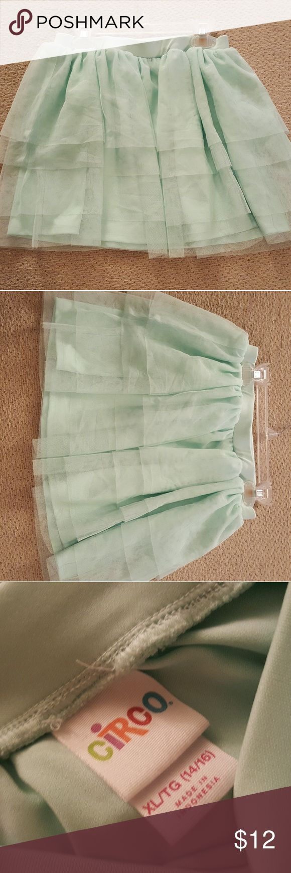 Great condition 😍 Mint green skirt 🤗 Only worn 3 times, this skirt is still in great condition and still looks new. My daughter wore this with leggings and you can dress this up or dress it down.. she unfortunately grew out of this cute skirt and I am sad she cannot wear this cute skirt anymore. Comes from a smoke free home! 🚭 Circo Bottoms Skirts