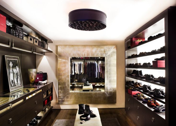 This sleak walk-in closet almost looks like a fashion boutique  www.bocadolobo.com #bocadolobo #luxuryfurniture #exclusivedesign #interiodesign #designideas #walkinclosetideas #bedroomideas #walkinclosets #boutique walk-in closets