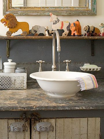 {rustic cabinet + porcelain bowl} keep in mind: when opting for a spread-fit faucet, select a model that raises the handles above the rim of the sink for easy operation | better homes and gardens
