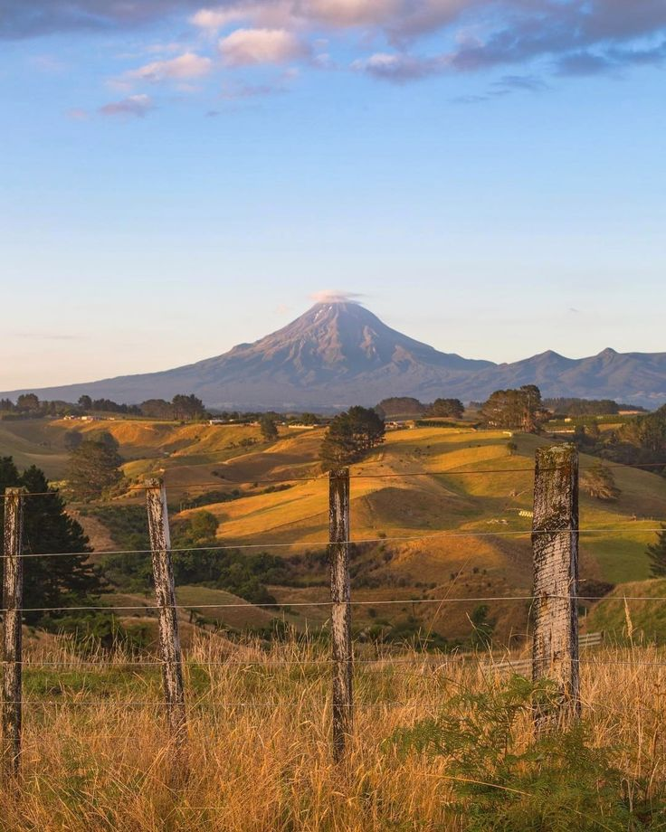 """""""Miles upon miles of rolling hills in Taranaki, a region I definitely need to spend more time in with a camera!"""" . credit: @trex.photography . C'monBoard #Travel brings together the most exclusive #travel destinations. To discover the most exquisite travel packages, check out the CB website [link in the bio] . . . . Best online travel booking sites? Keep an eye on our website."""