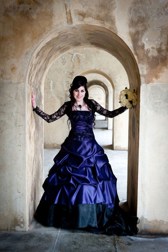 This spectacular Purple and Black Wedding Dress from WeddingDressFantasy is created with a Couture construction and is available in many
