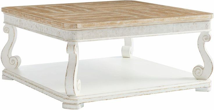 Traditional scroll carvings sit at the corners of the generously-sized base of the Juniper Dell Square Cocktail Table. A thick and thin plank pattern is uniquely captured in four frames on the English Clay finished top. Bordered by vertical beaded moulding and softened by radiused corners at the top and bottom, the Square Cocktail table displays a humble simplicity that is a hallmark of French Country design.