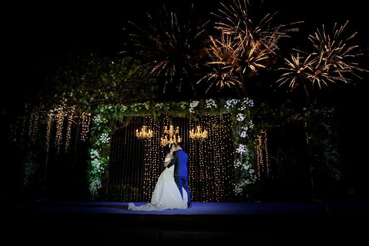 Wedding stage Greenery Theme  First dance, kiss and fireworks Night Reception Bone the wedding by IS Cinema Bali wedding destination