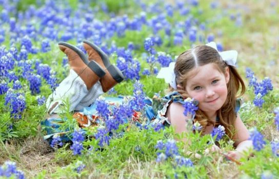 This is one of 20 finalists in the Houston Chronicle's 2014 rodeo photo contest. You can see the rest of the entries and vote for your favorite here: http://www.chron.com/life/article/Houston-Rodeo-Photo-Contest-5270431.php.  This picture is of my daughter Abby laying in the field of bluebonnets last spring in Kingwood, TX. 14 - Brandy Whisenant