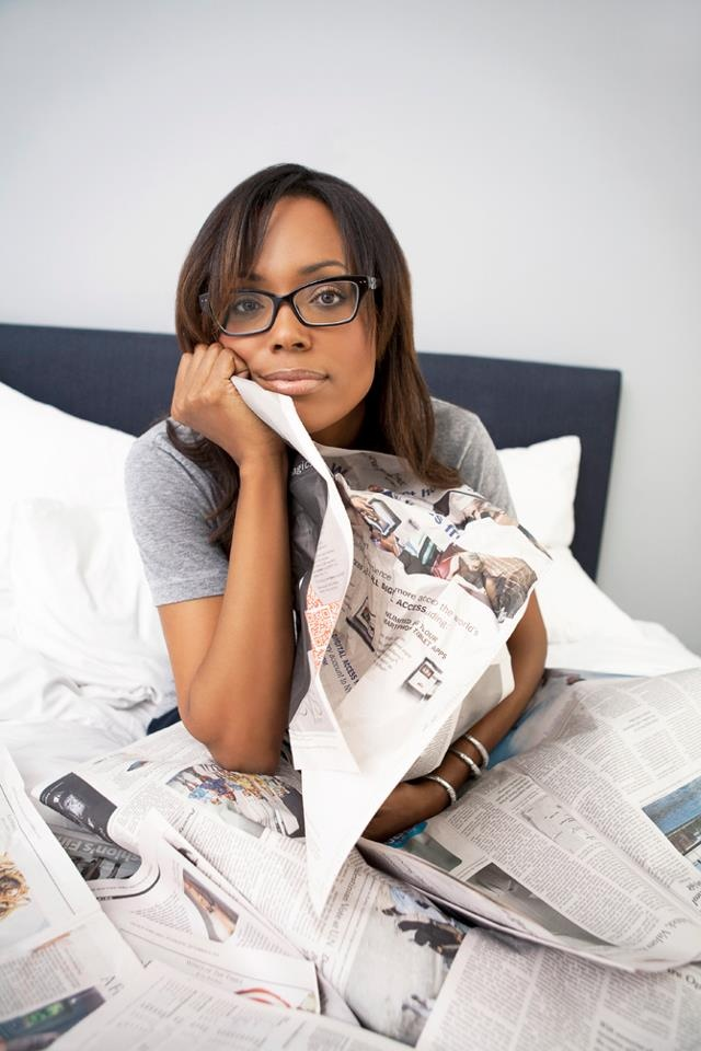 Aisha Tyler - Comedian, TV Host, writer...  I like this pic of her with her glasses.
