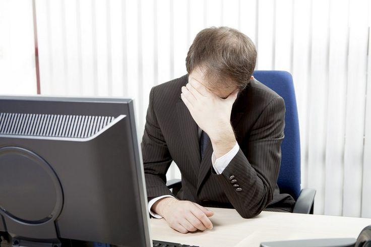 Despairing businessman at his desk