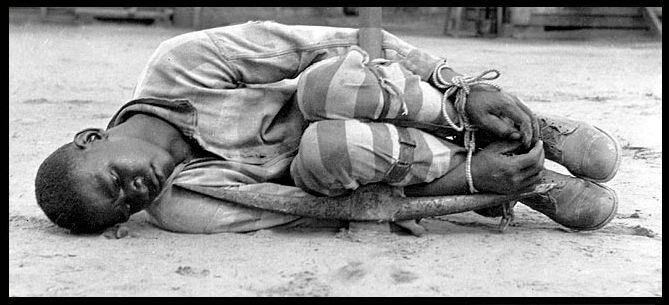 Slave wrapped around a pole. He was set there and left to die.