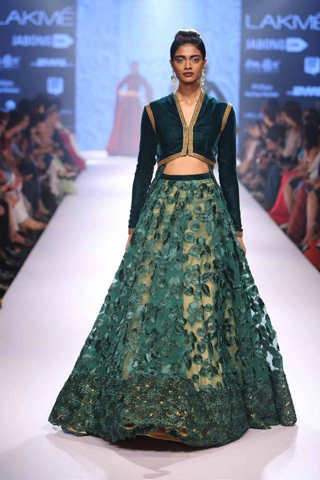 Love the drama in the Lehenga...seen at Lakme Fashion Week 2015. See more such outfits from the show at www.frugal2fab.com