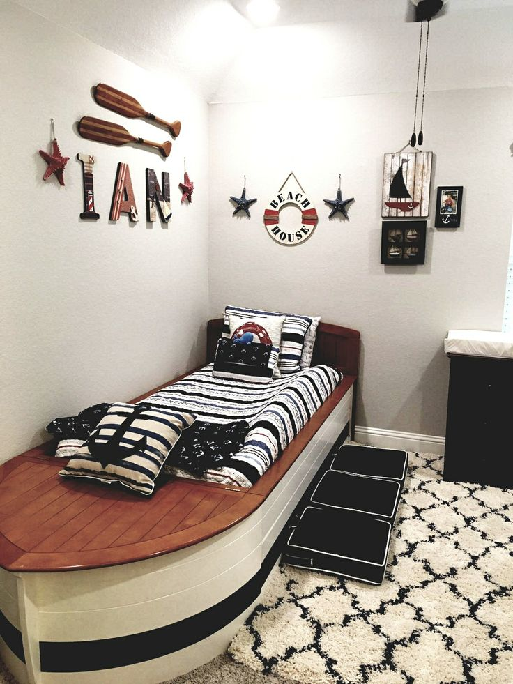 My son's nautical themed bedroom came to life with a #boatbed, decorative #oars, and custom letters