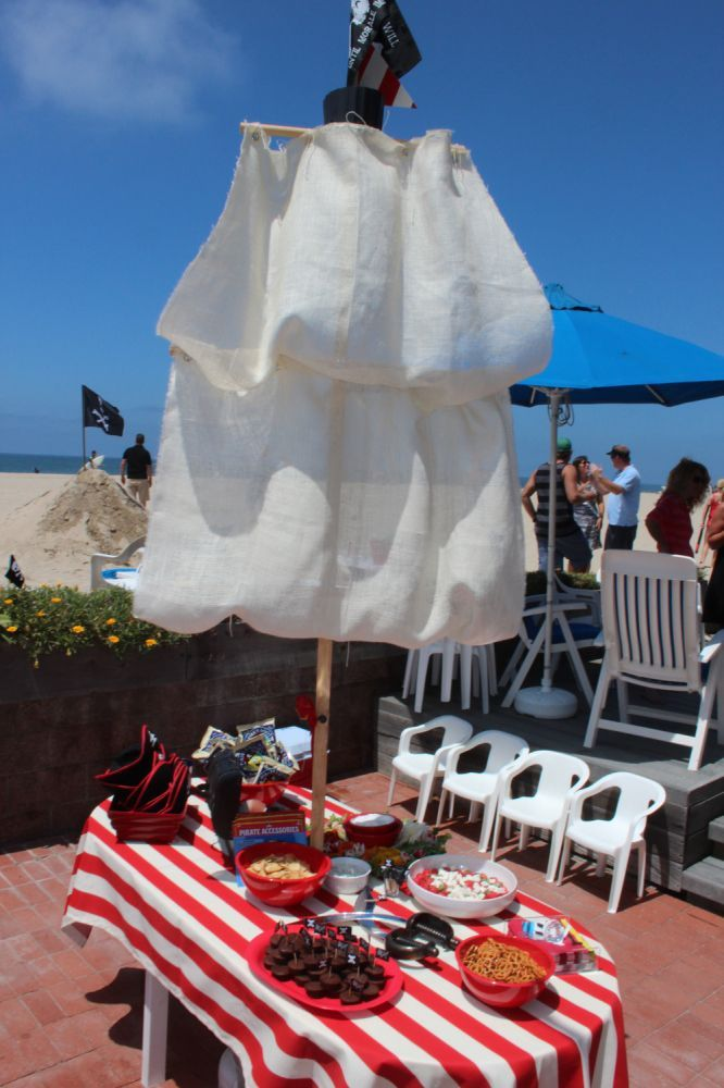 pirate ship table w/striped tablecloth!, captains = adults, first mates = kids, pirate nap book as favors 2nd Birthday Party :: Pirate Theme